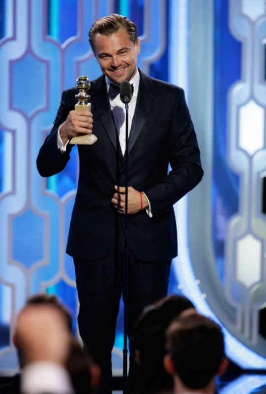 Leonardo DiCaprio With the Best Actor Golden Globe Award for The Revenant