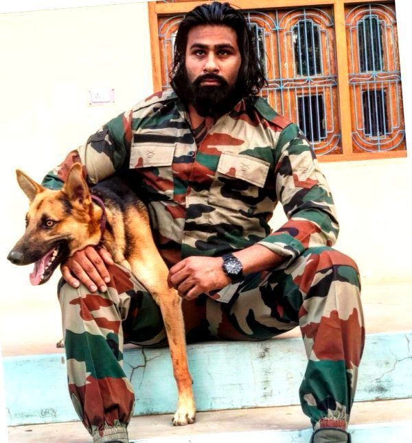 Rinku Singh with a dog