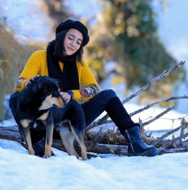 Riya Mavi playing with a dog