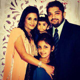 Shardul Singh Bayas with his wife and daughters
