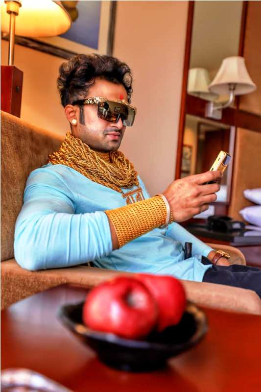 Sunny Waghchoure Holding his Gold Phone