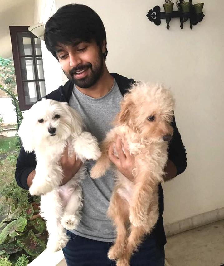 Kalyaan Dhev with his pet dogs