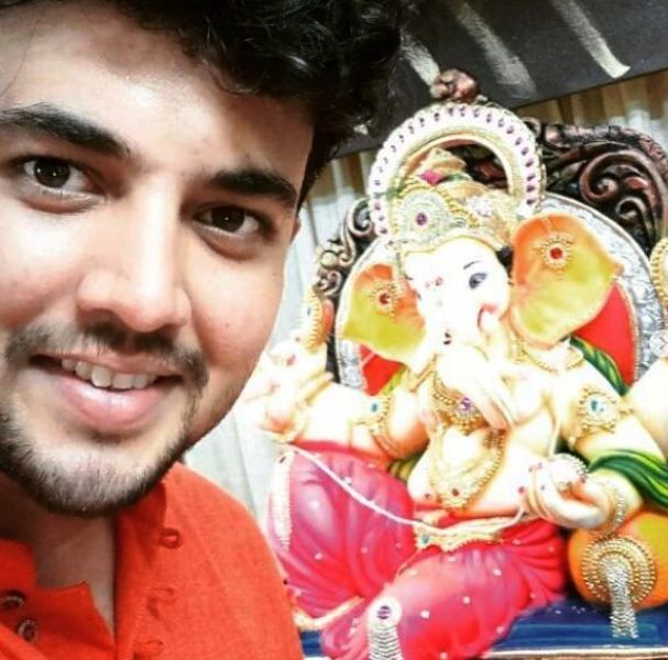Prasad Jawade with an Idol of Lord Ganesha