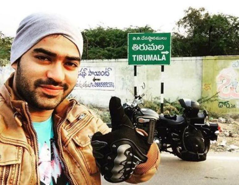 Shine Shetty Posing with His Motorcycle
