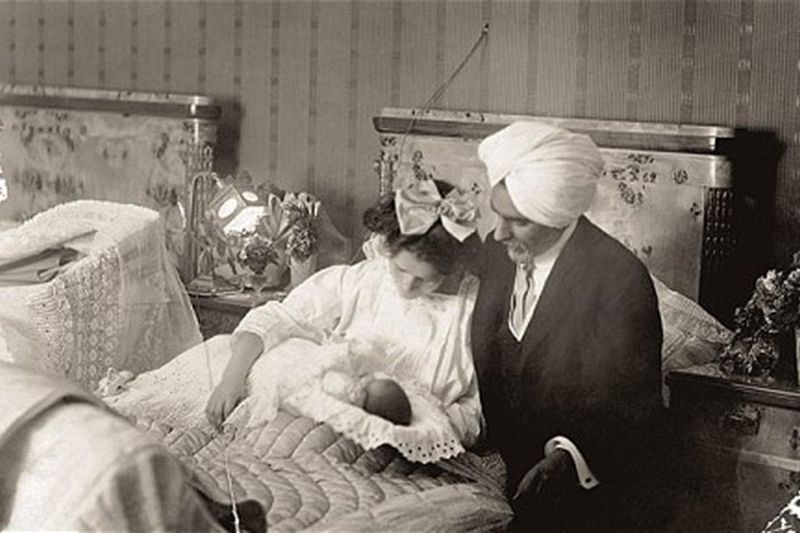 A Photograph of Newborn Amrita with her Parents