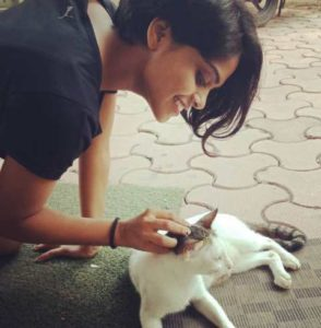 Sonal Vichare playing with a cat