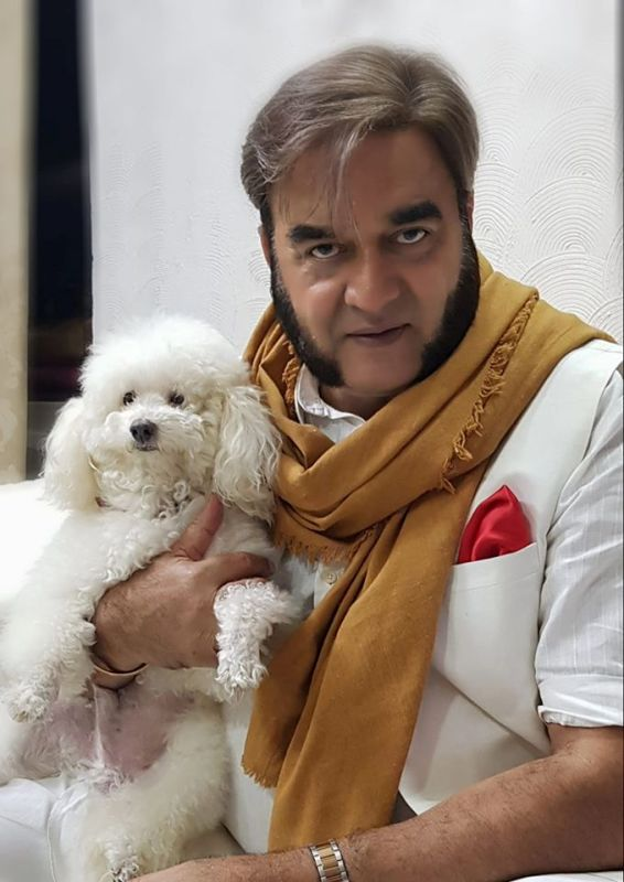 Surendra Pal With His Pet Dog Kaju