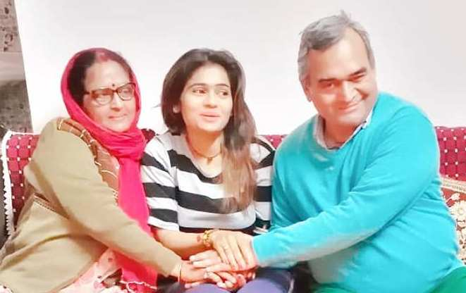 Gauri Mishra with her parents