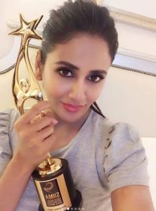 Parul Yadav with an award