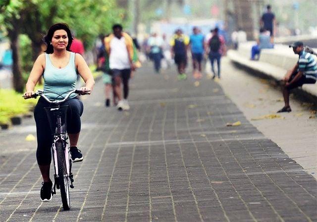 Devita Saraf riding a bicycle at Marine Drive in Mumbai