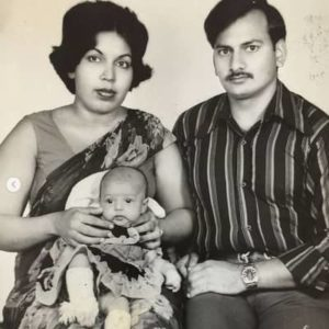 Flora Saini with her parents
