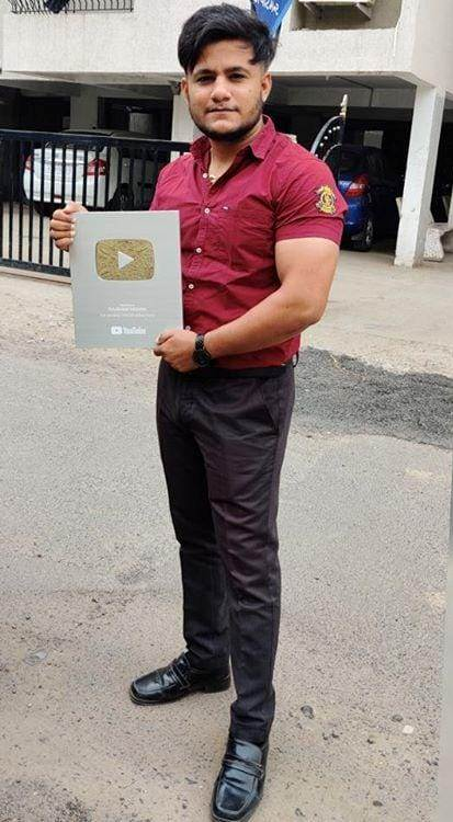 Shubham Mishra Showing His YouTube Silver Play Button