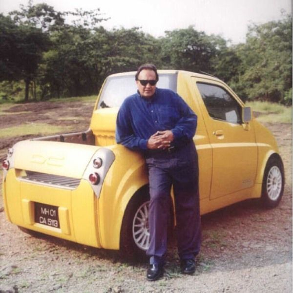 An old photo of Dilip Chhabria with a customized car