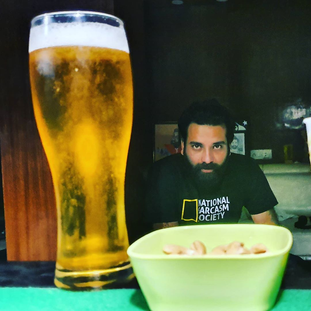 Anubhav Bassi with a glass of beer