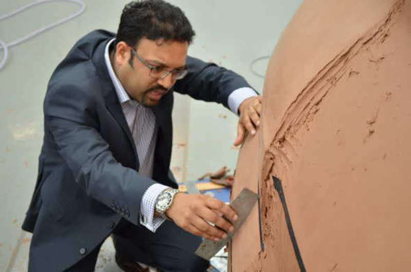 Pratap Bose working on a clay model of a car