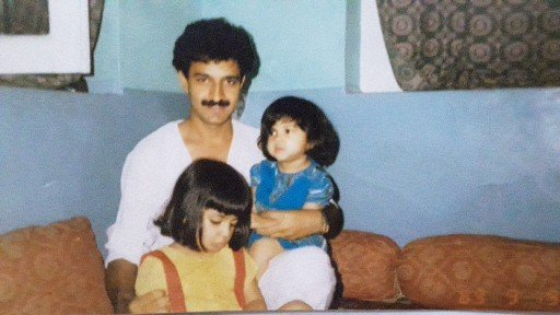 A childhood picture of Iltija sitting on her father's lap