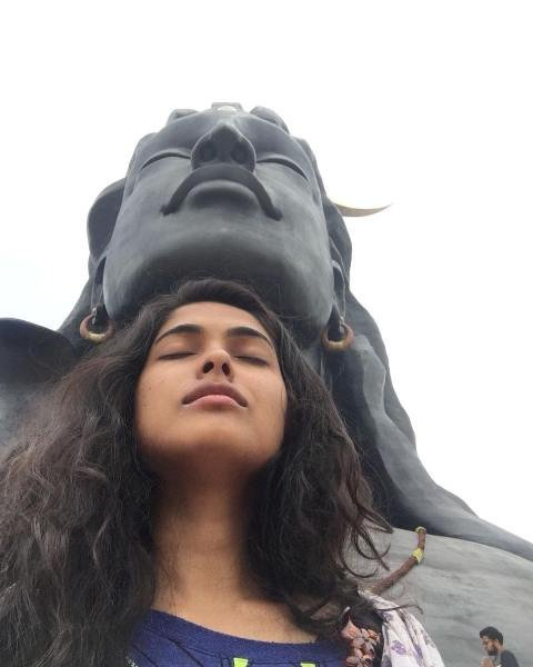 Divi Vadthya with the idol of Lord Shiva