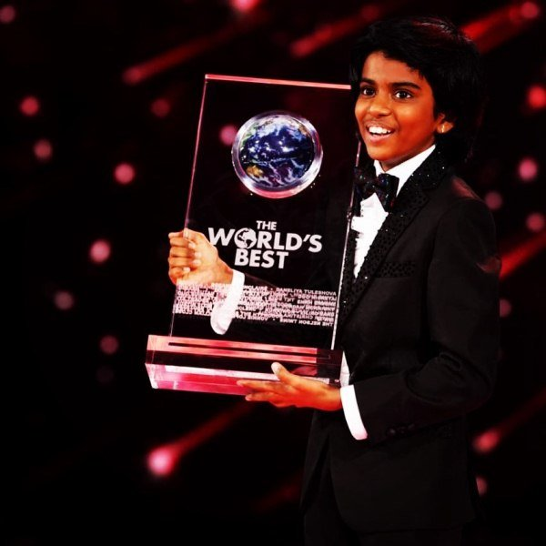 Lydian Nadhaswaram with the trophy of the talent show