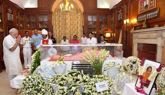 Narendra Modi paying his last respects at the mortal remains of Suvra Mukherjee