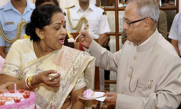 Pranab Mukherji offering cake to his wife
