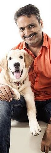 S. P. Charan With His Pet Dog