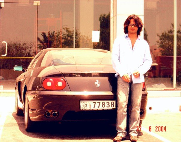 Sam Bombay with his car