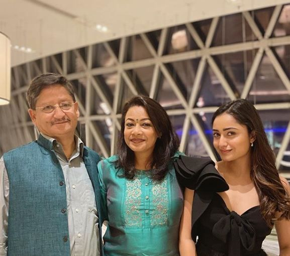 Tridha Choudhury with her parents