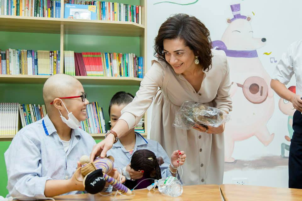 Anna Hakobyan interacting with cancer-ridden children in an Armenian hospital
