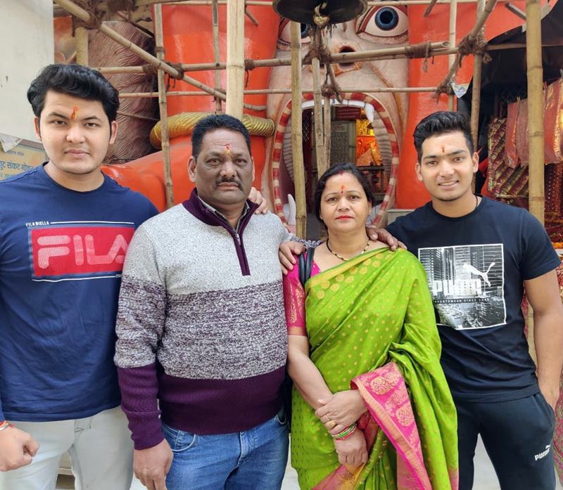 Anuj Rawat with his elder brother and parents