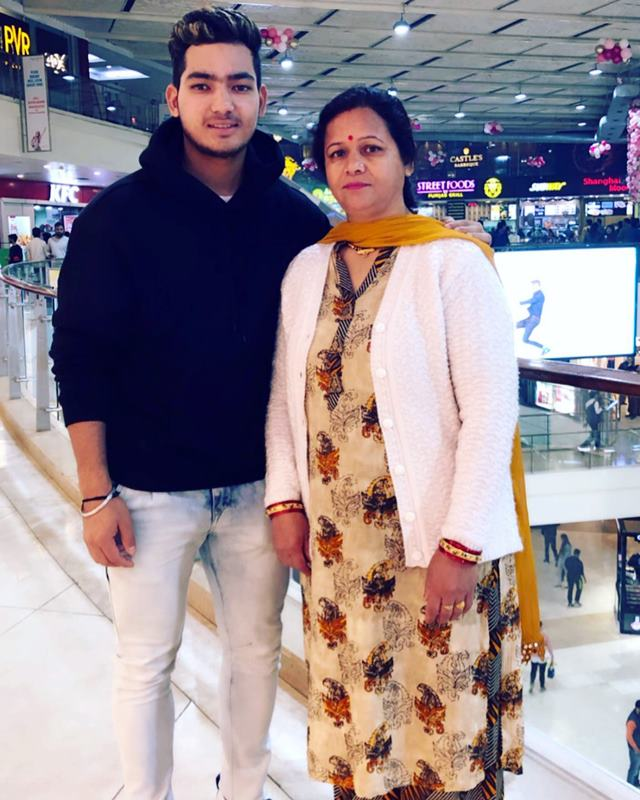 Anuj Rawat with his mother