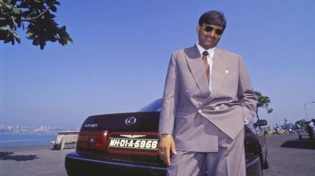 Harshad Mehta posing next to with his Toyota Lexus