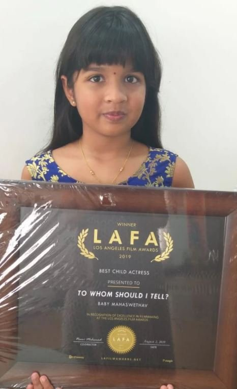 "Mahaswetha with the Best Child Actress award at Los Angeles Film Awards 2019 for her role in the short film titled ""To Whom Should I tell"""