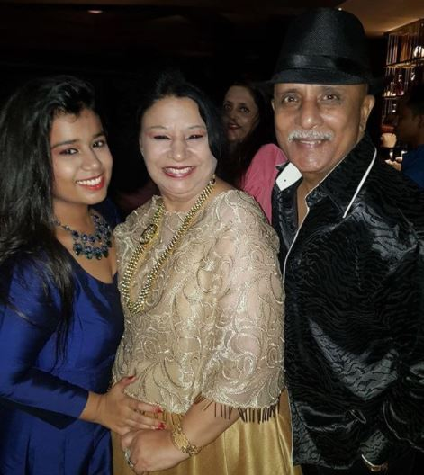 Rajesh Puri with his wife and daughter