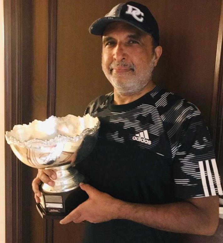 Sanjay Jha posing with his Runners Up trophy he won at the Willingdon Club Memorial Tennis Tournament 2019