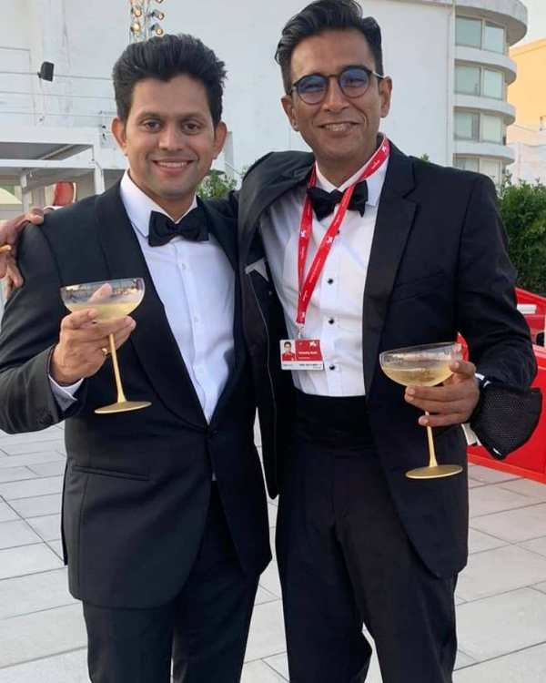 Vivek Gomber (right) drinking alcohol at the Venice Film Festival
