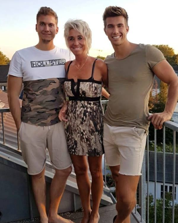 Christian Betzmann with his mother and brother
