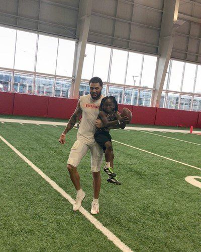 Rudolph Ingram playing football with professional American footballer Mike Evans
