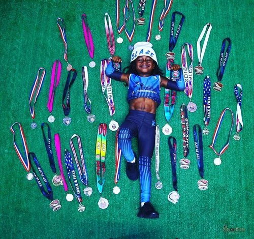 Rudolph Ingram with his medals