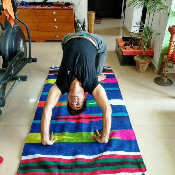 Saurabh Dwivedi performing wheel pose