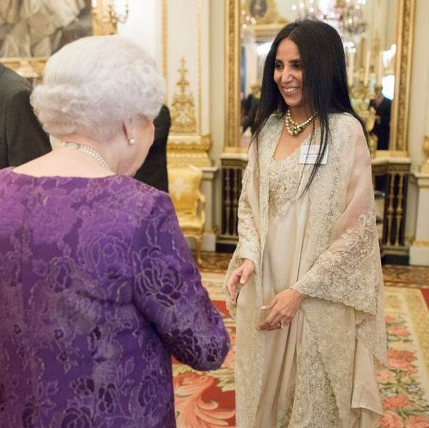 A picture of Anamika Khanna meeting The Queen of England