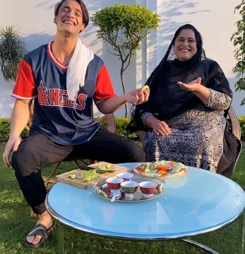 Asim Riaz with his mother