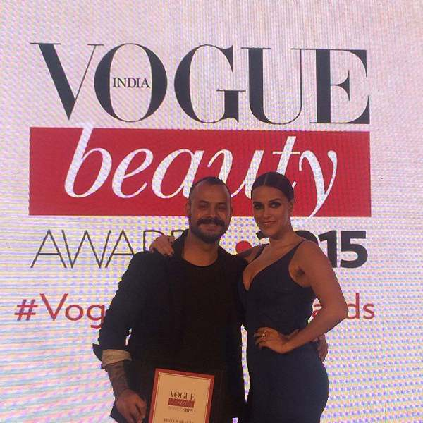 Daniel Bauer receiving Vogue Beauty Award in 2015