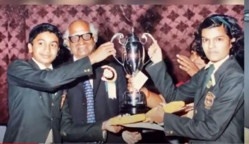Guarang Dasa winning a trophy in school