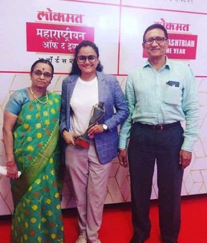 Kalyanee Mulay with her parents