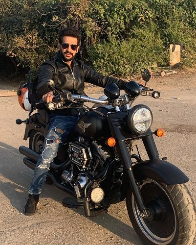 Karan Veer Mehra sitting on his motorcycle