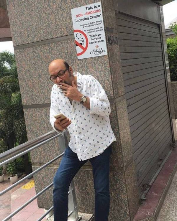 Mickey Contractor smoking