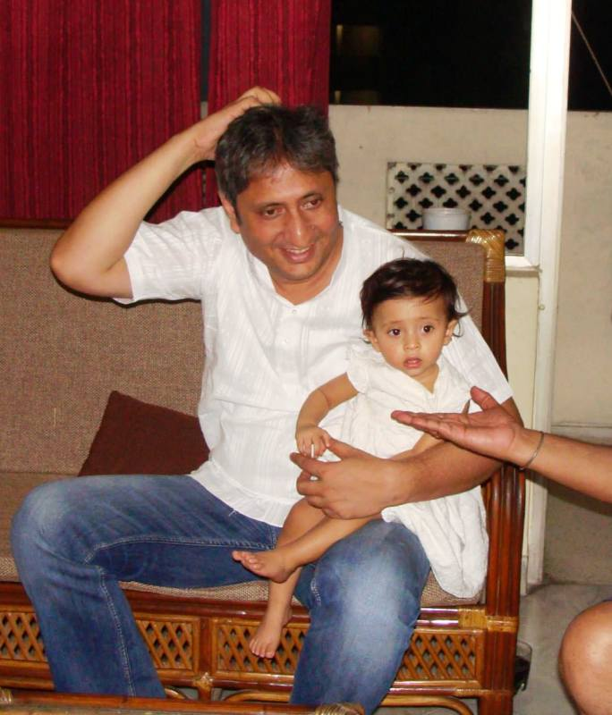 A picture from 2013, featuring Nayana's husband, Ravish Kumar, with their younger daughter