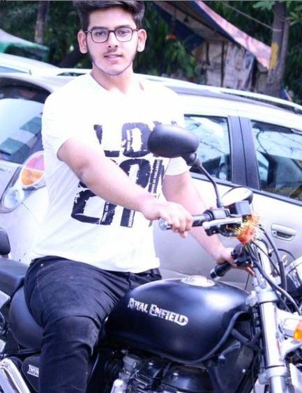 Vyomesh Koul posing with his bike
