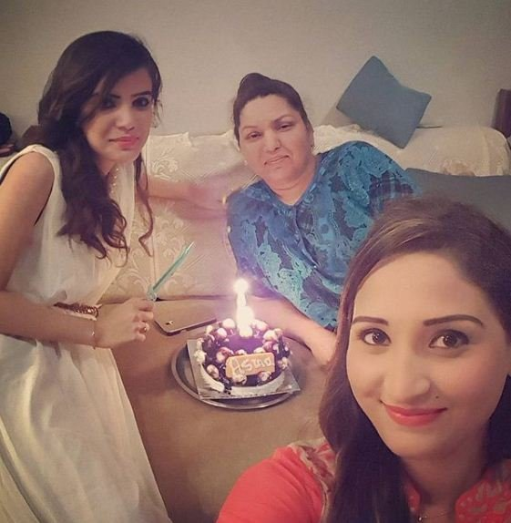 Amza Fallah with her mother and sister