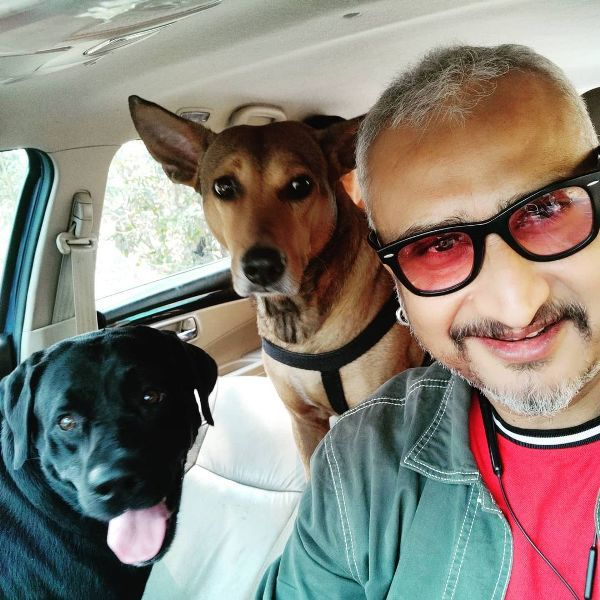 Awdhesh Mishra with his pet dogs